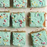 Sliced sugar cookie bars on parchment paper.