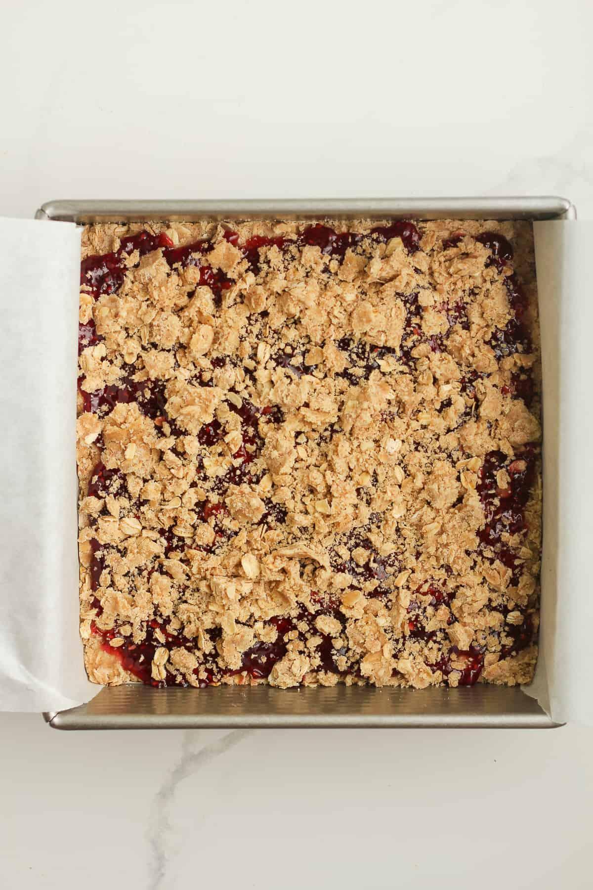 An 8x8 pan of raspberry jam bars before baking.