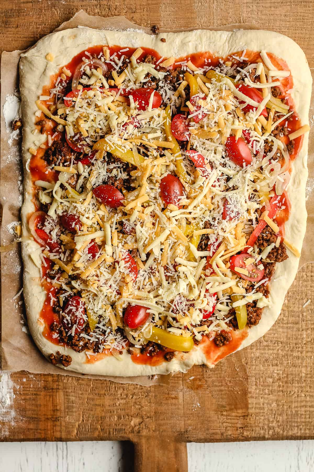 Unbaked taco pizza.