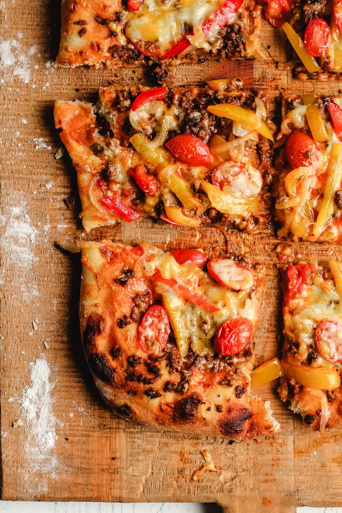 Sliced taco pizza.