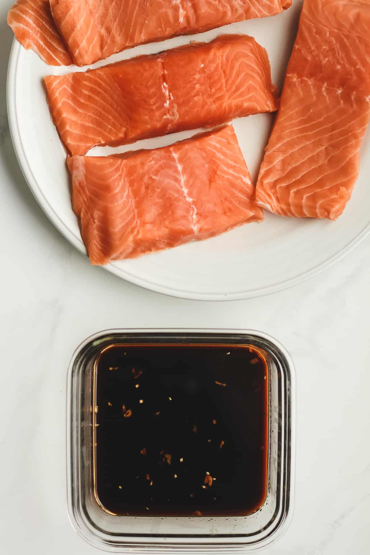 A plate of raw salmon with the Asian marinade.