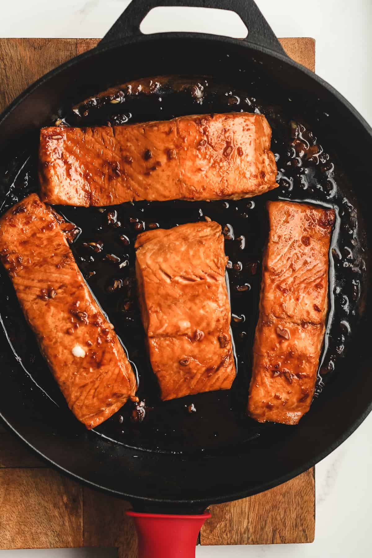 A skillet of cooked salmon.