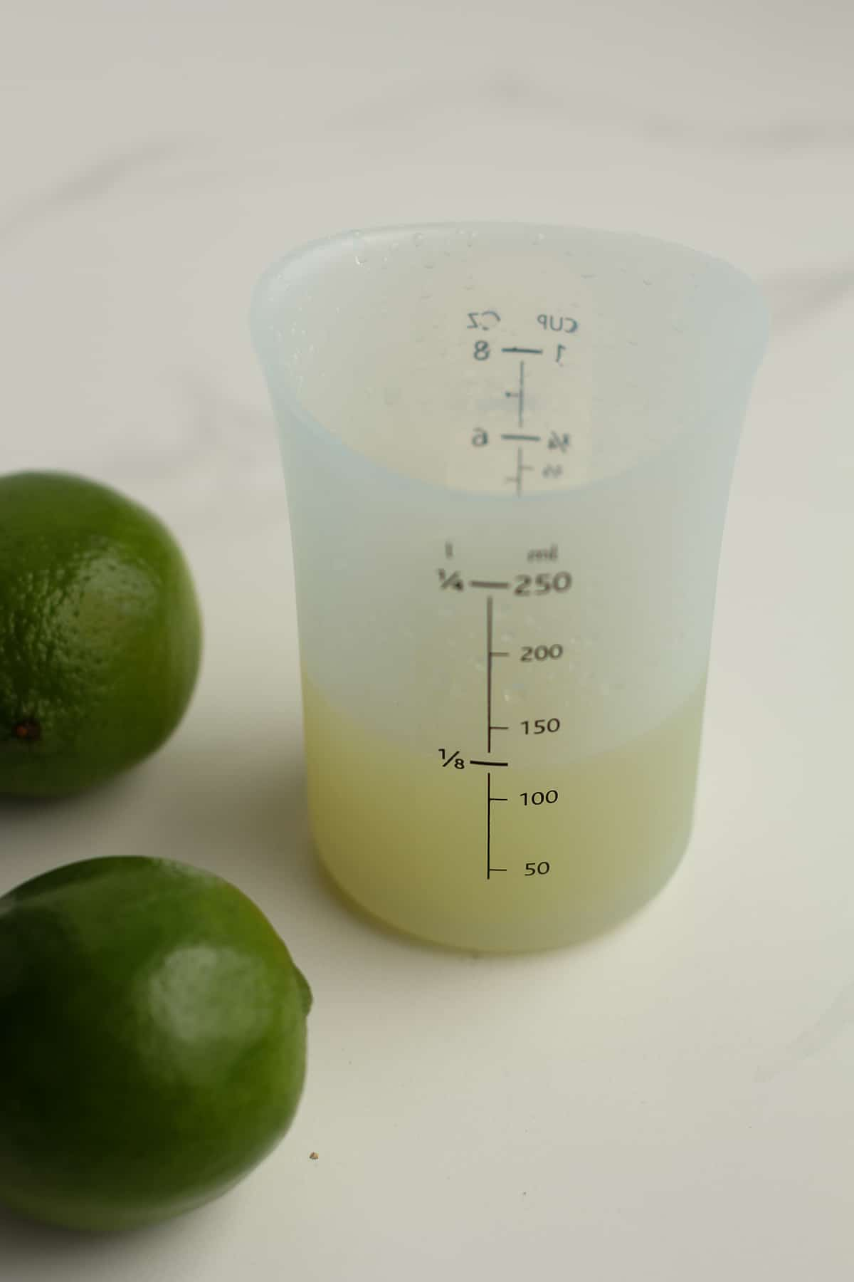 Side shot of freshly squeezed lime juice.