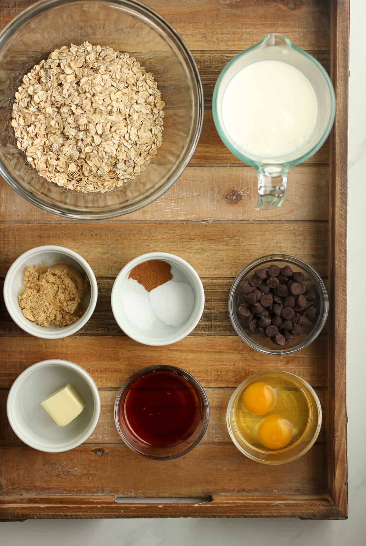 A brown tray of baked oatmeal ingredients.