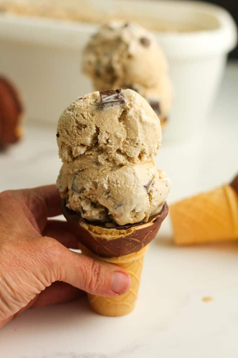 My hand on a coffee toffee ice cream cone.