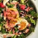 A bowl of fried goat cheese salad with strawberry dressing on top.