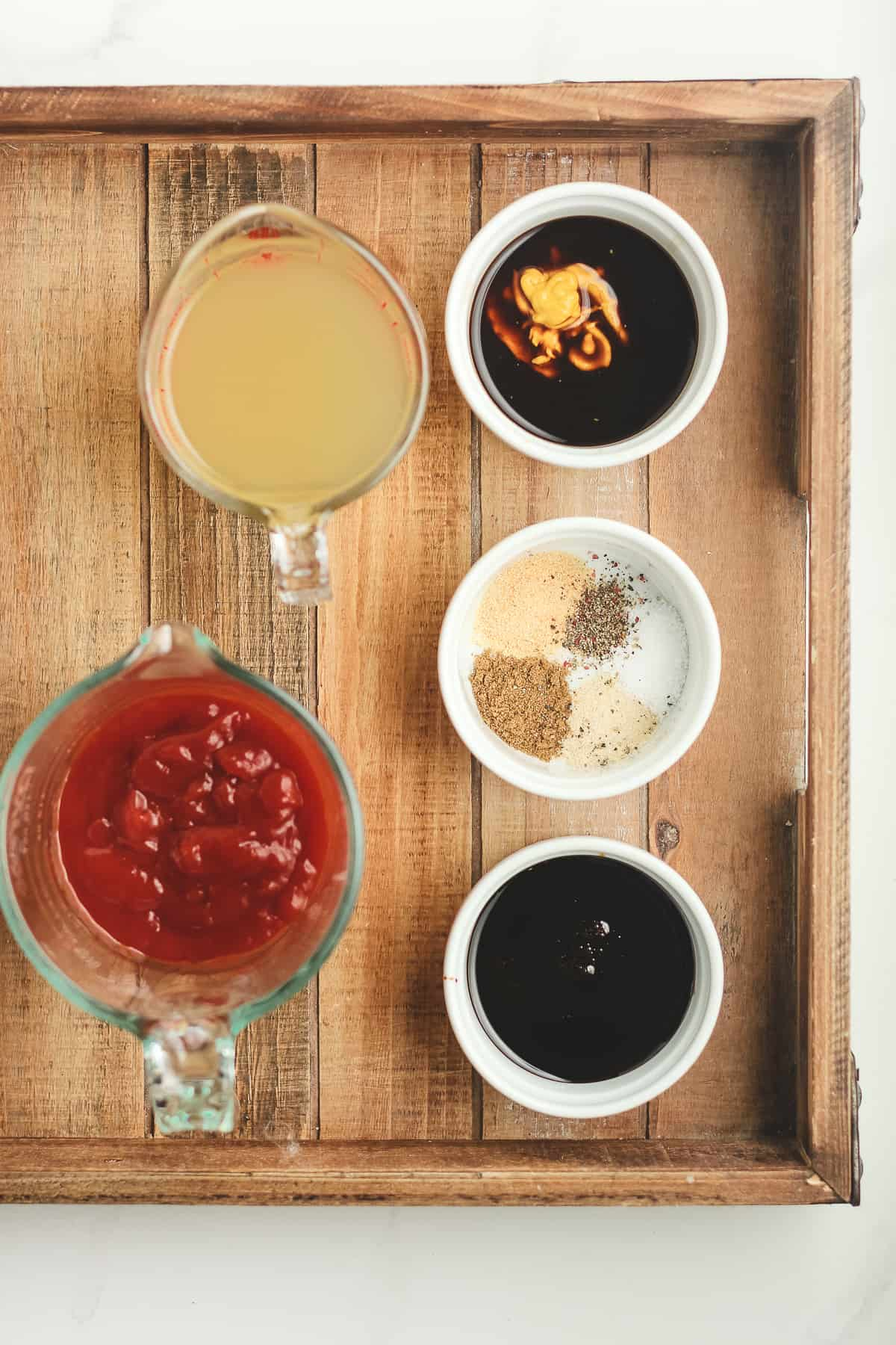 A tray of the ingredients for homemade barbecue sauce.