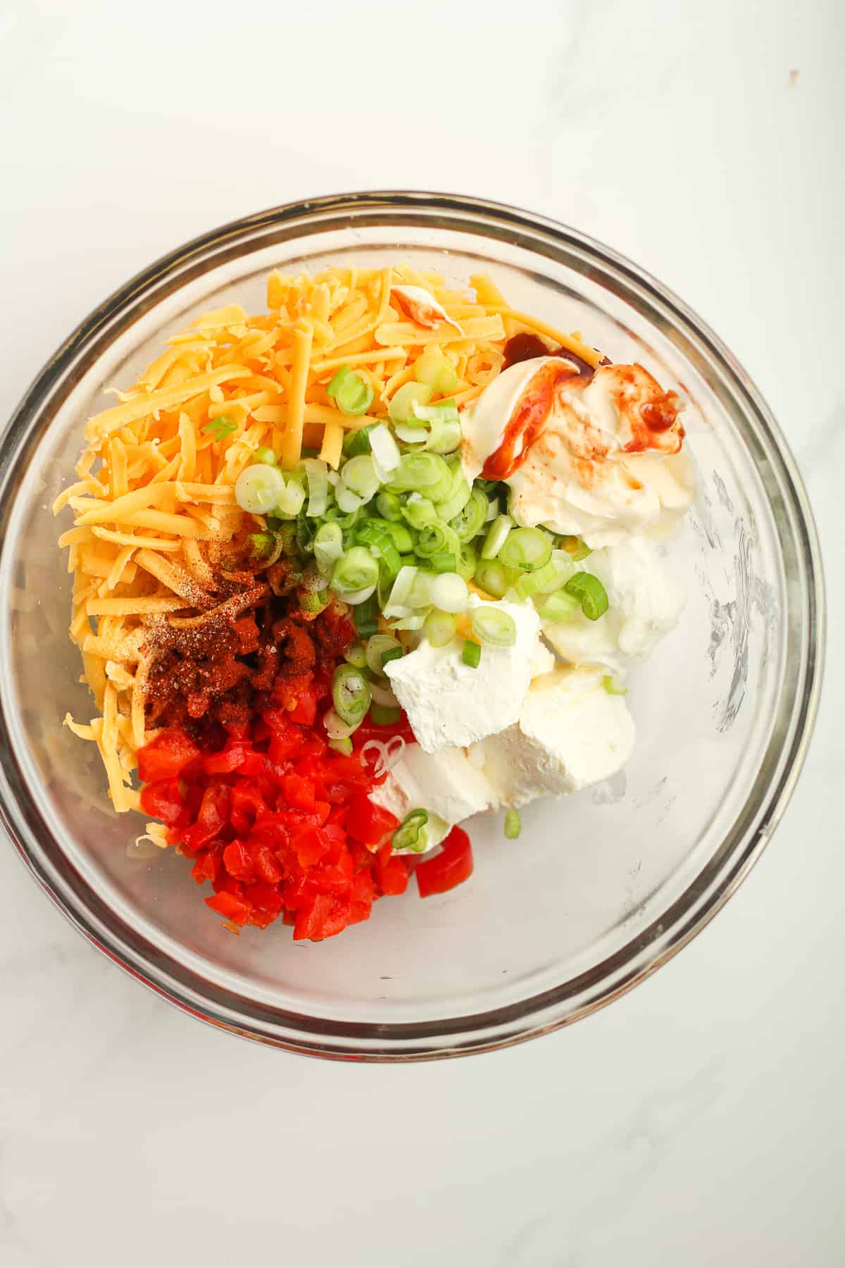 A bowl of the pimento cheese ingredients.