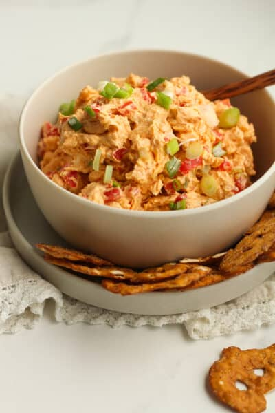 A bowl of southern pimento cheese, with pretzel crisps.