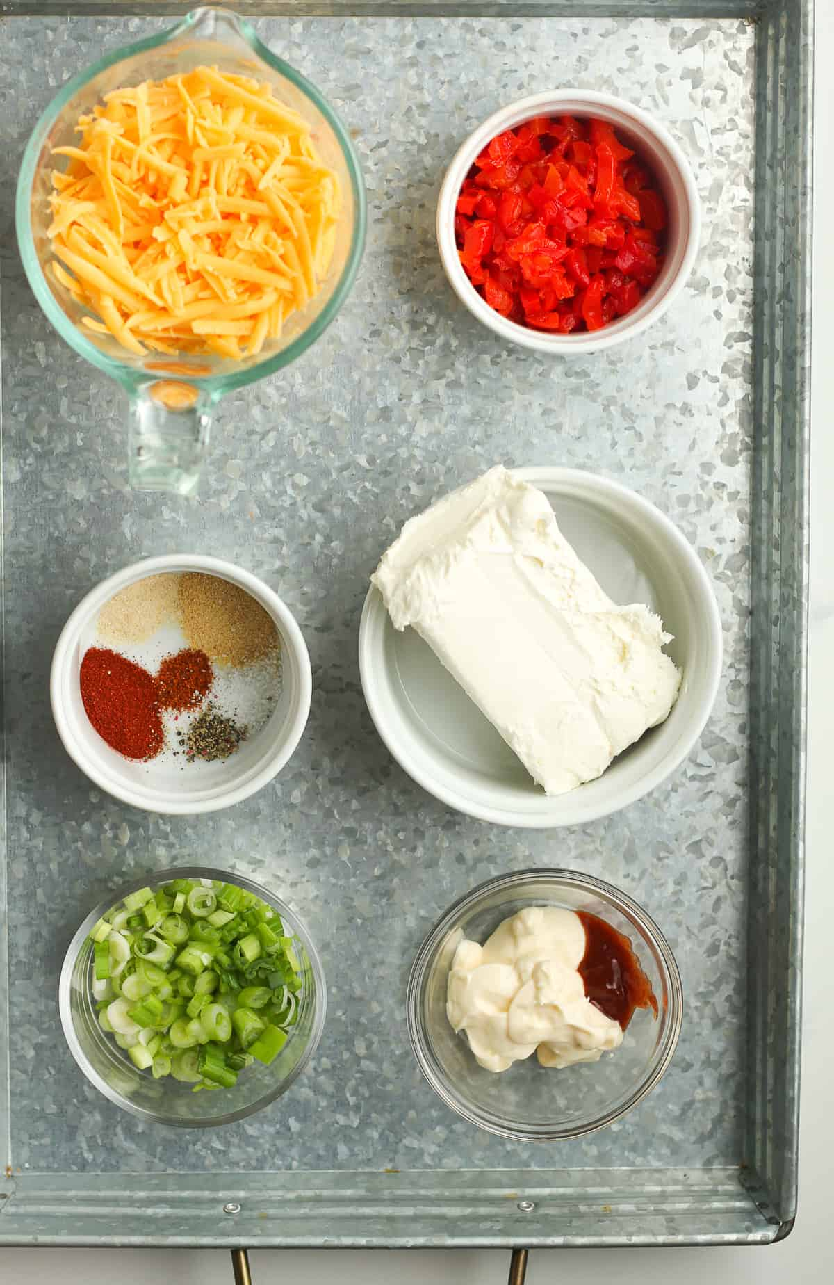 A tray of the ingredients for pimento cheese.