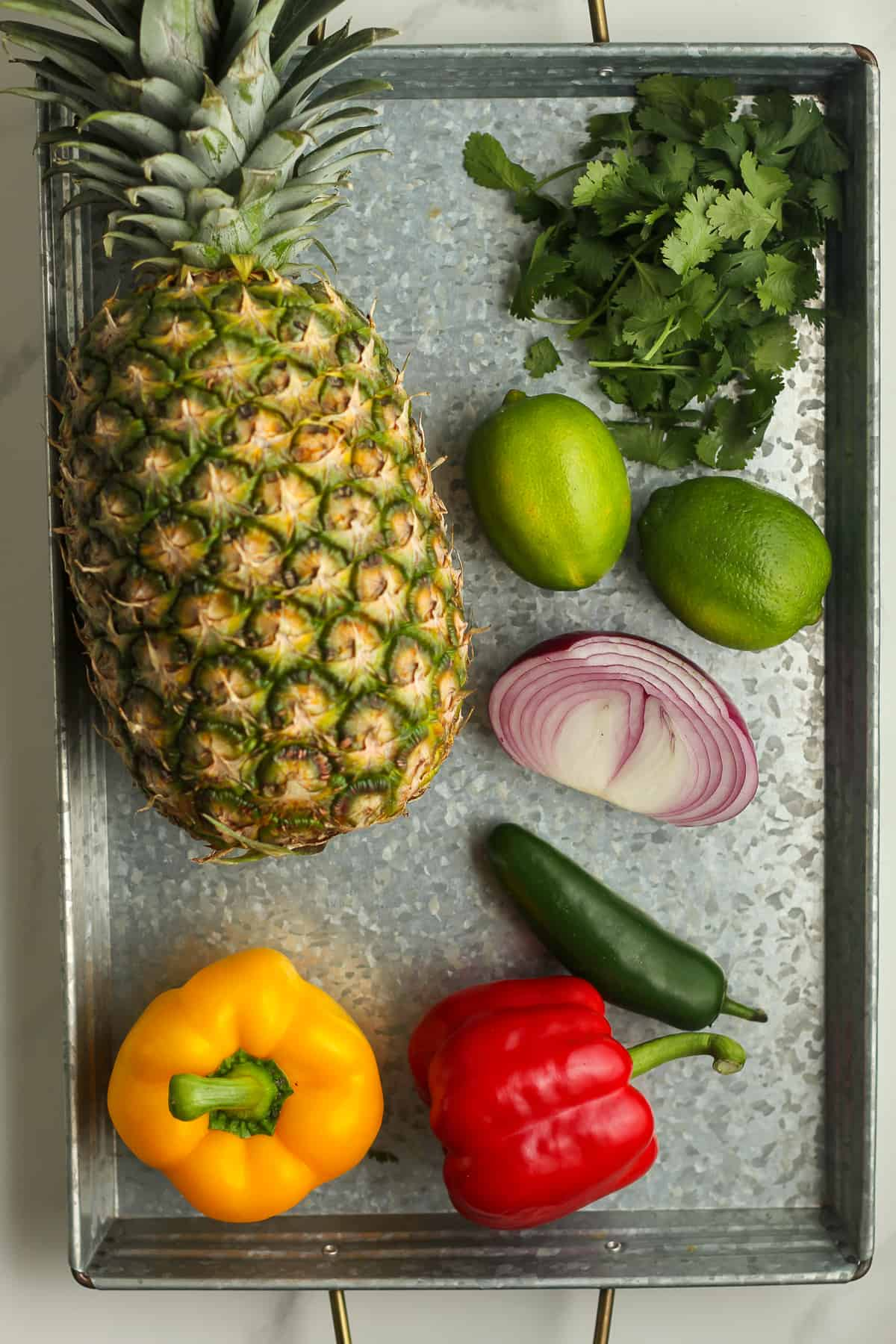 A tray of the pineapple and veggies for the salsa.