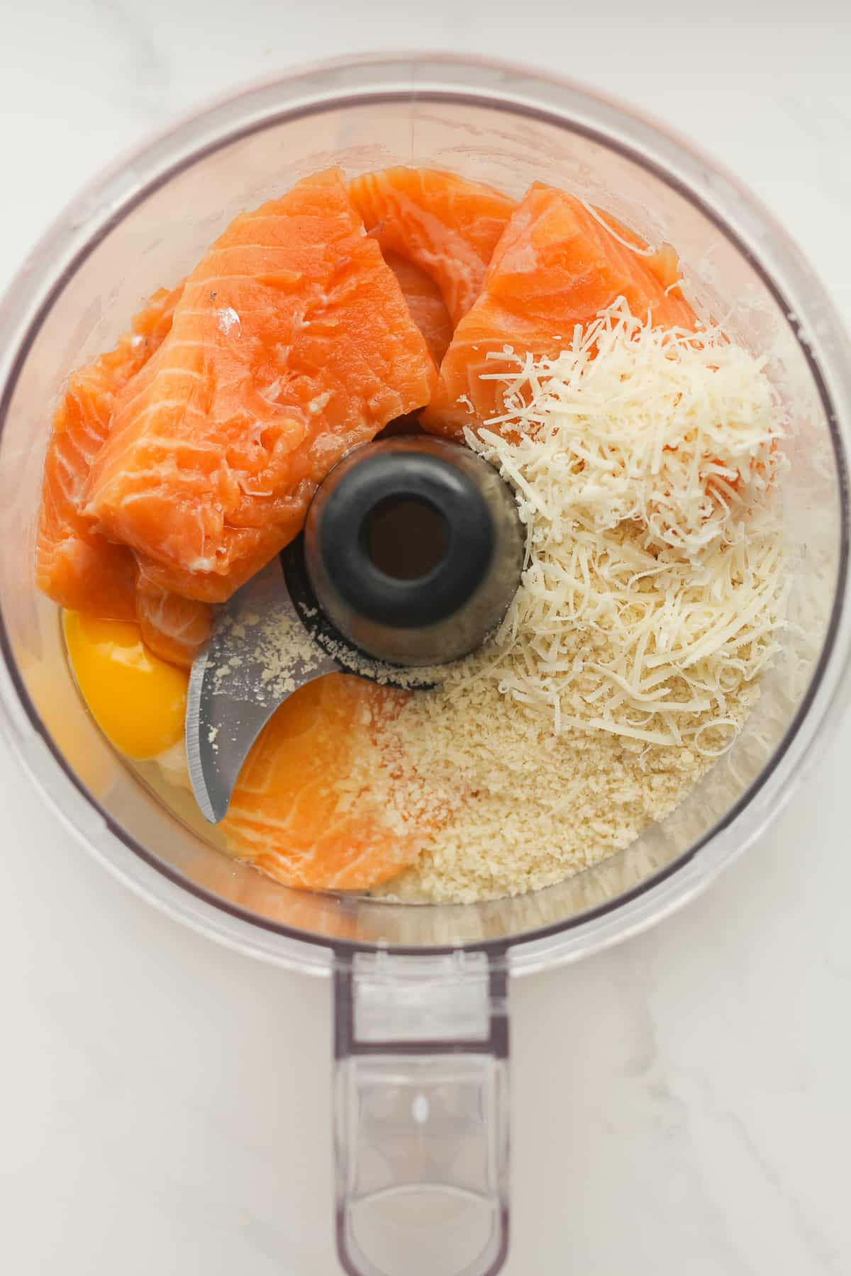 A food processor with the salmon ingredients.
