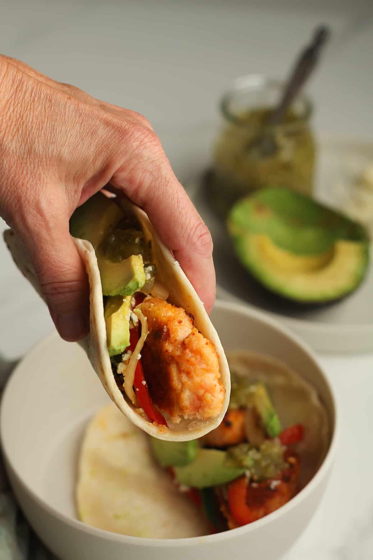 My hand holding a blackened salmon taco.