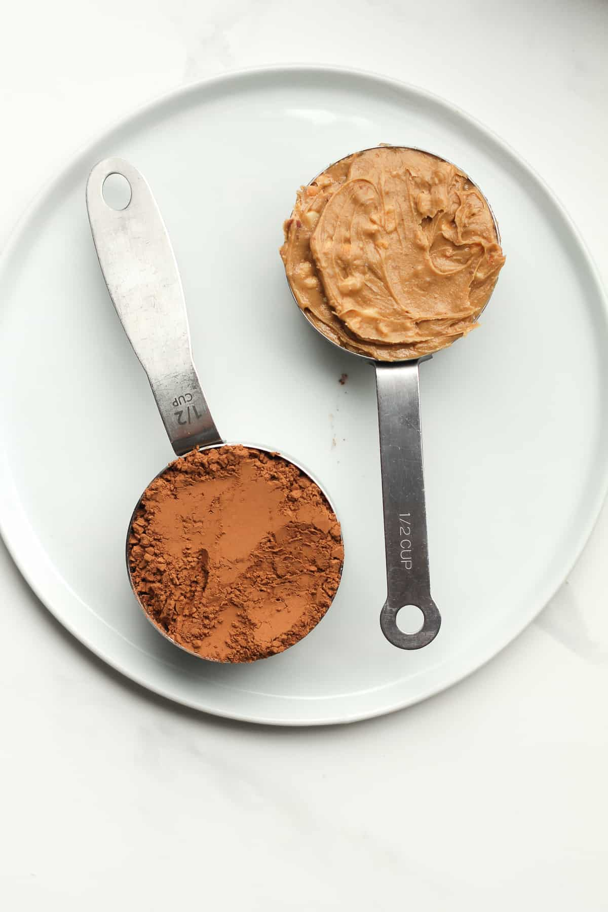 Two 1/2 cups of peanut butter and cocoa powder.