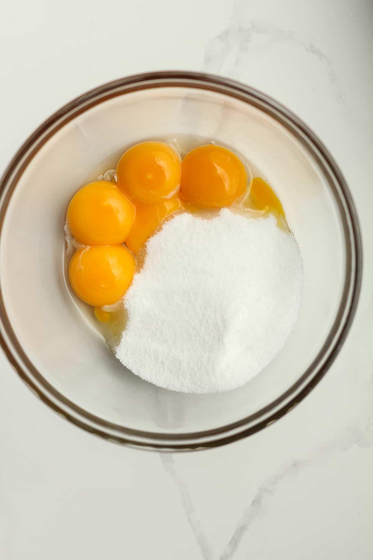 Egg yolks plus sugar in a bowl.
