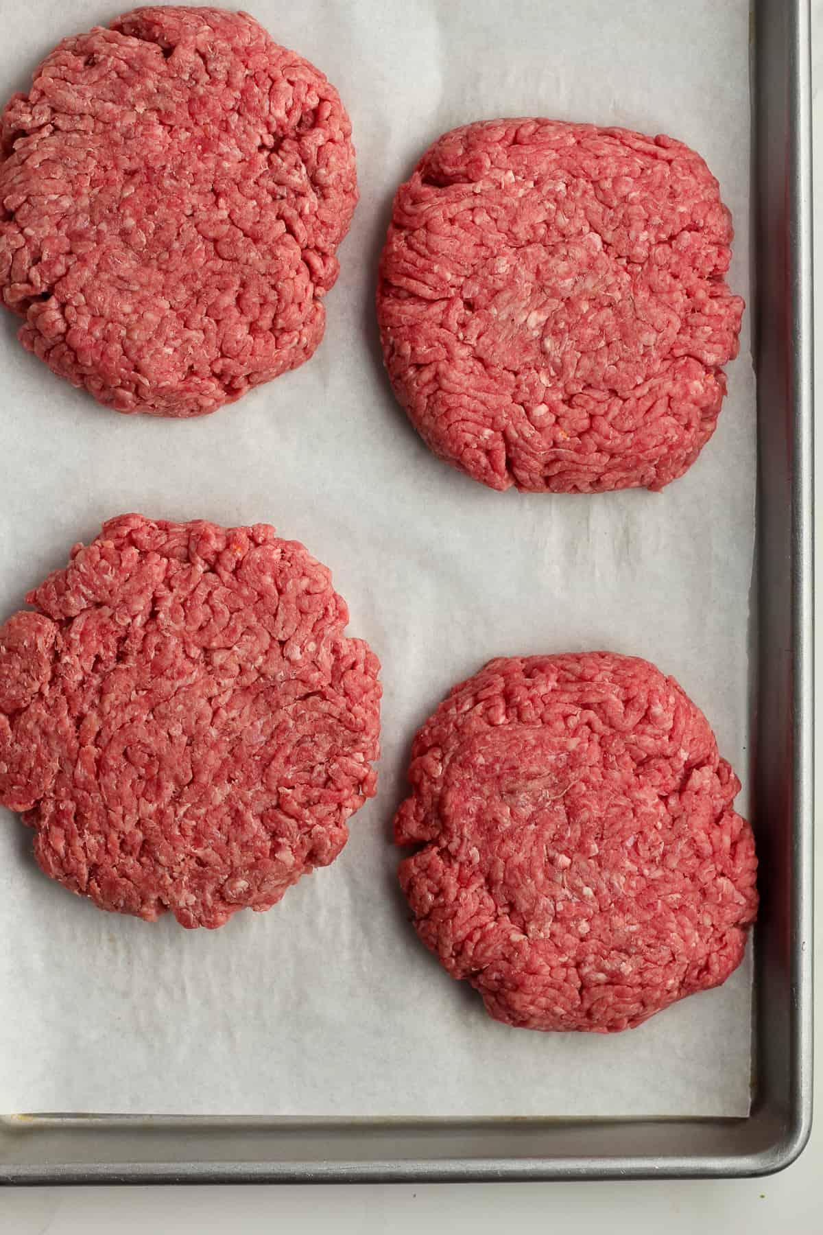 Four ground beef patties.