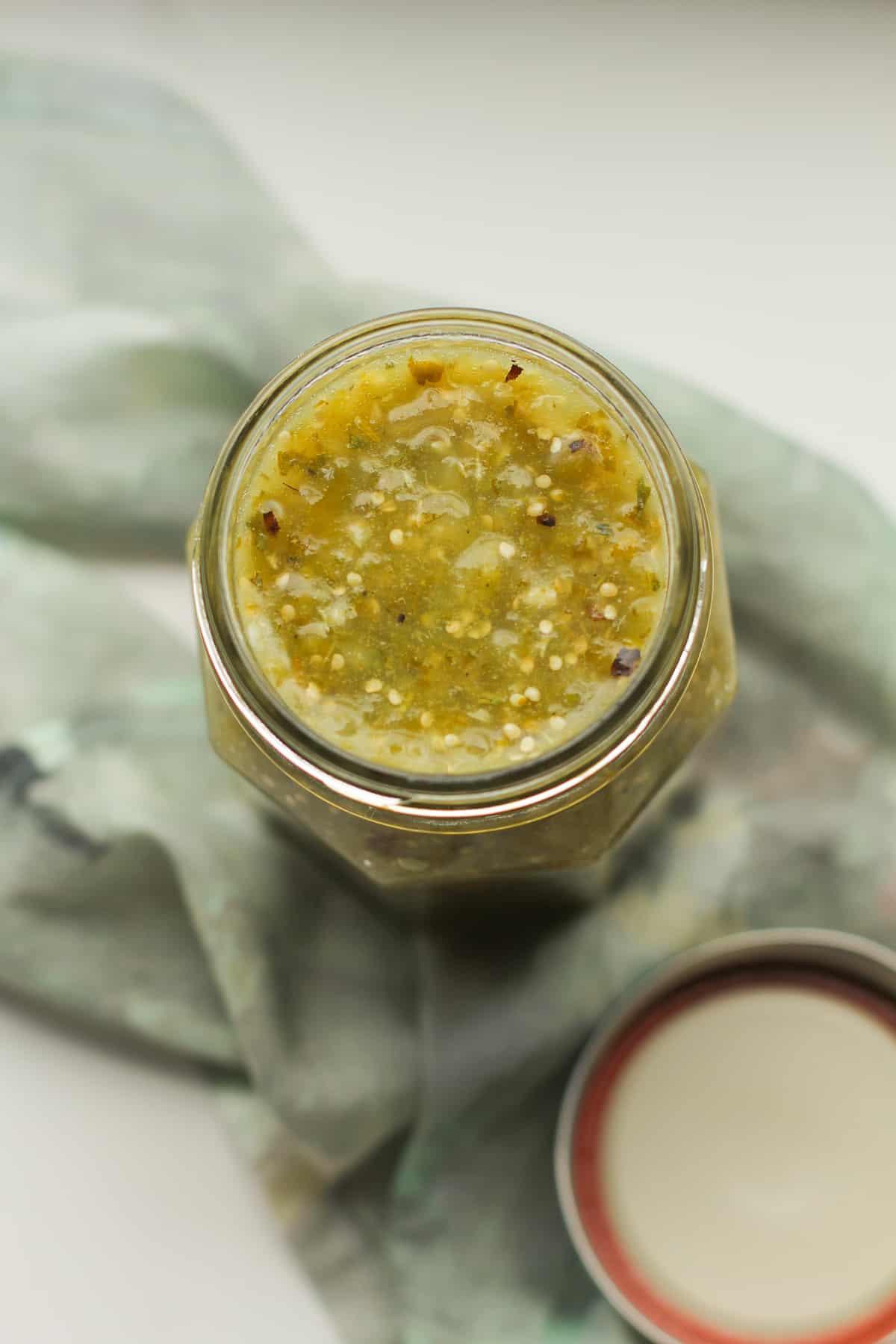 Overhead shot of a jar of homemade salsa verde.