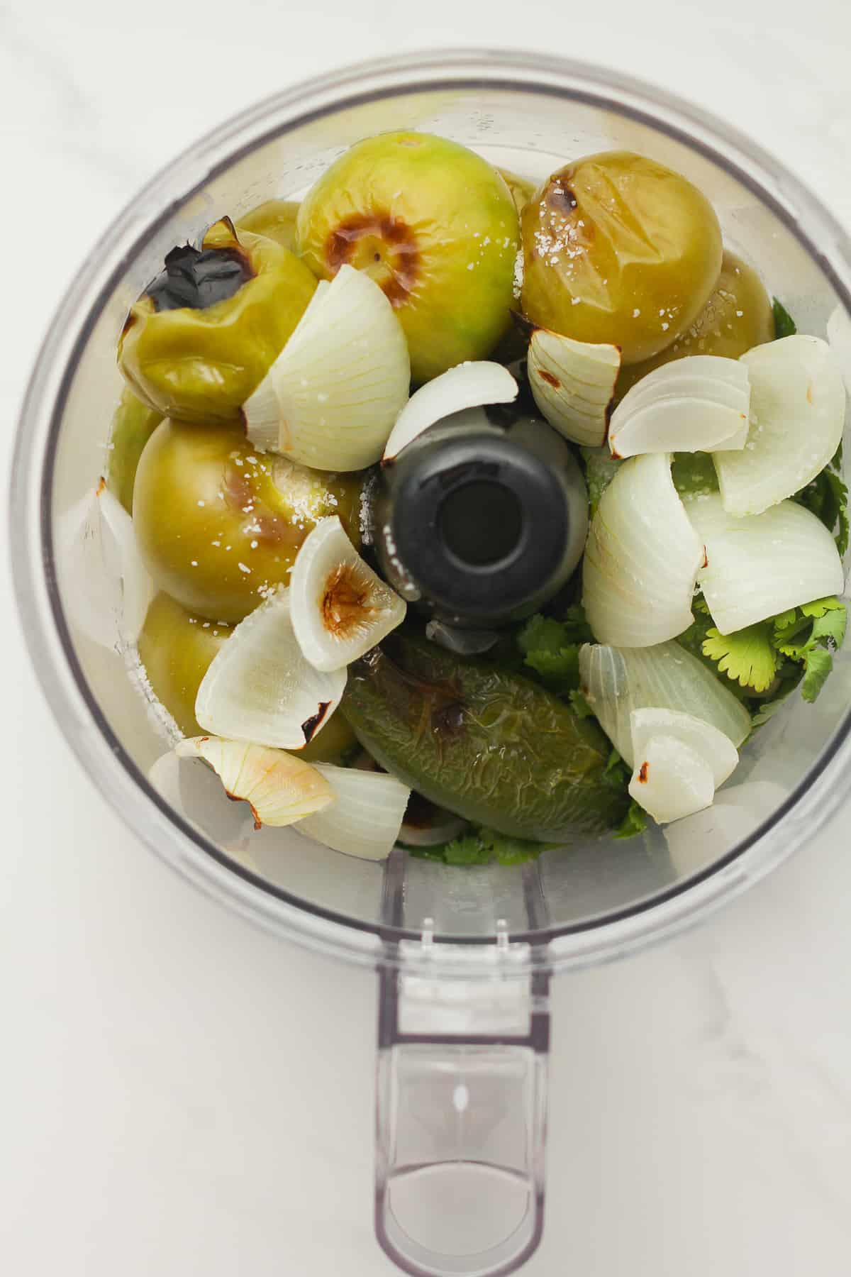 a food processor of the ingredients for salsa verde.