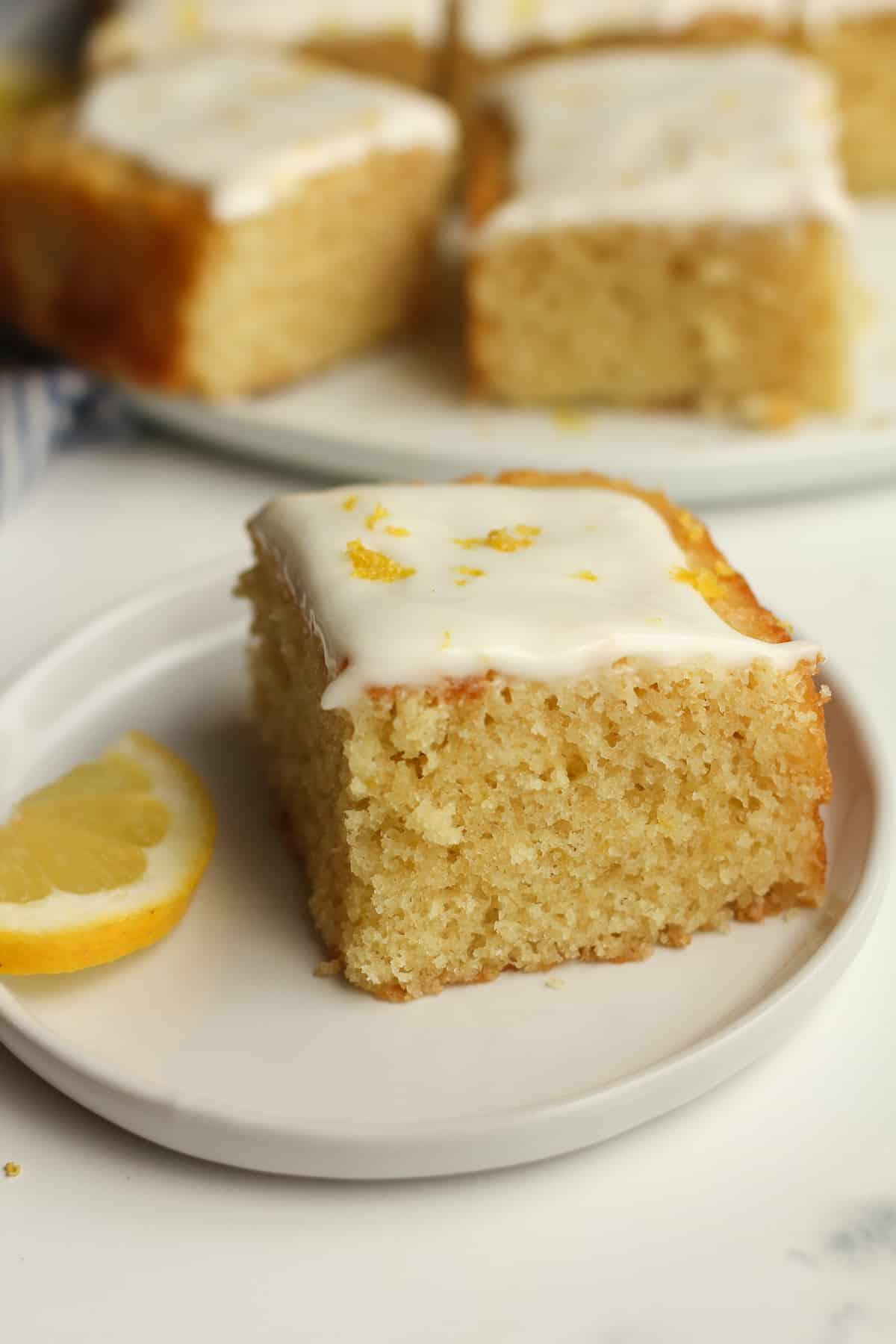 Side shot of a slice of lemon cake.