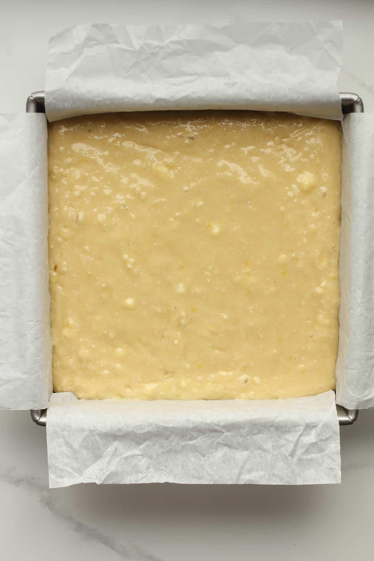 A pan of the batter of lemon cake.