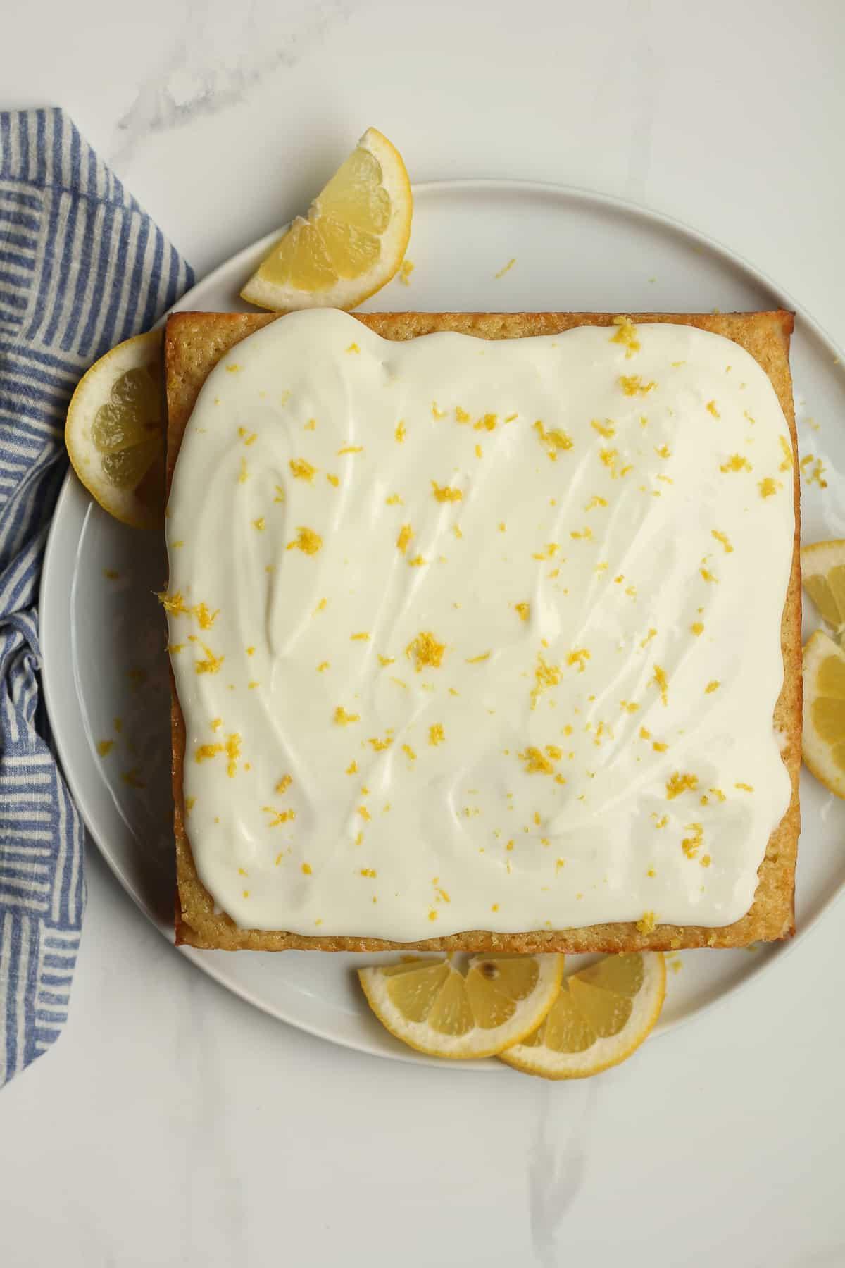 A square lemon cake from scratch with lemon zest.