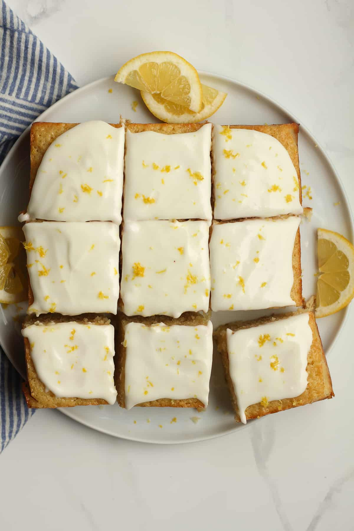 A plate of 9 pieces of lemon cake.
