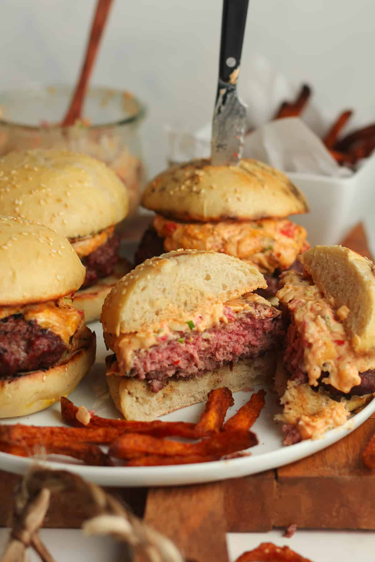 The pimento burgers on a plate, with one cut in half.