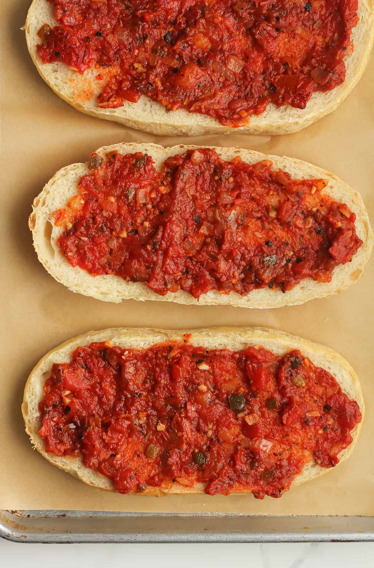 Homemade pizza sauce on French bread.