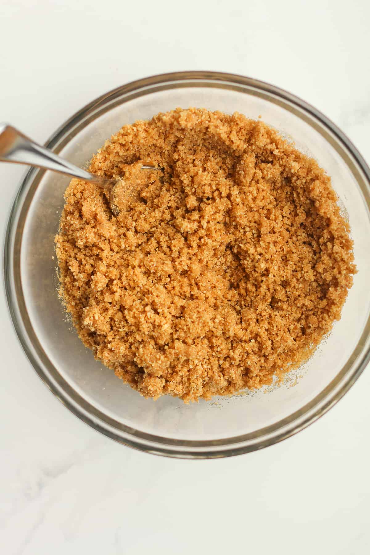 A bowl of the buttered graham cracker crumbs.