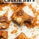 A s'mores cookie bar with a bite out with crumbs.