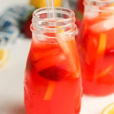 Two glasses of vodka strawberry lemonades.