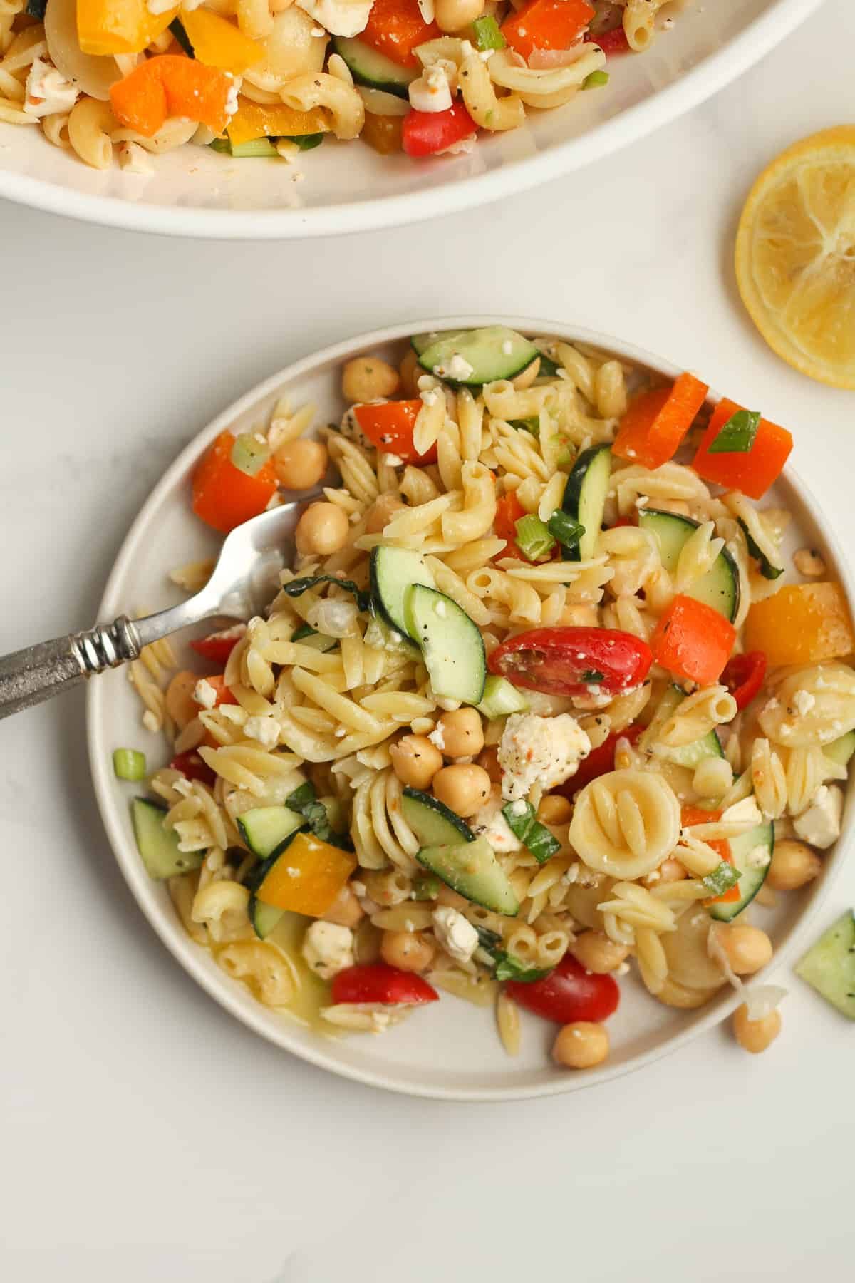 Overhead view of pasta salad with a fork.