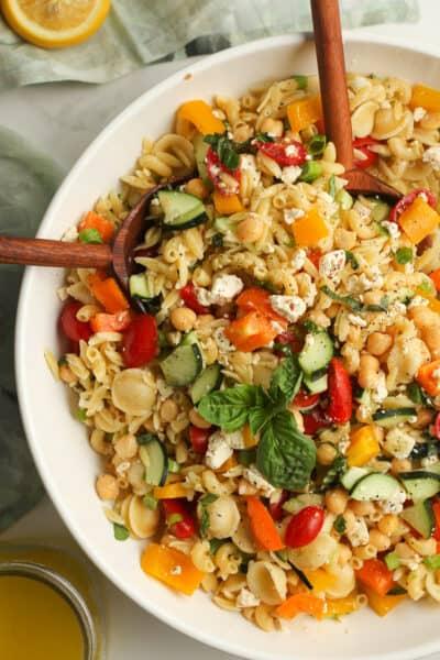 Closeup on a large bowl of summer pasta salad.