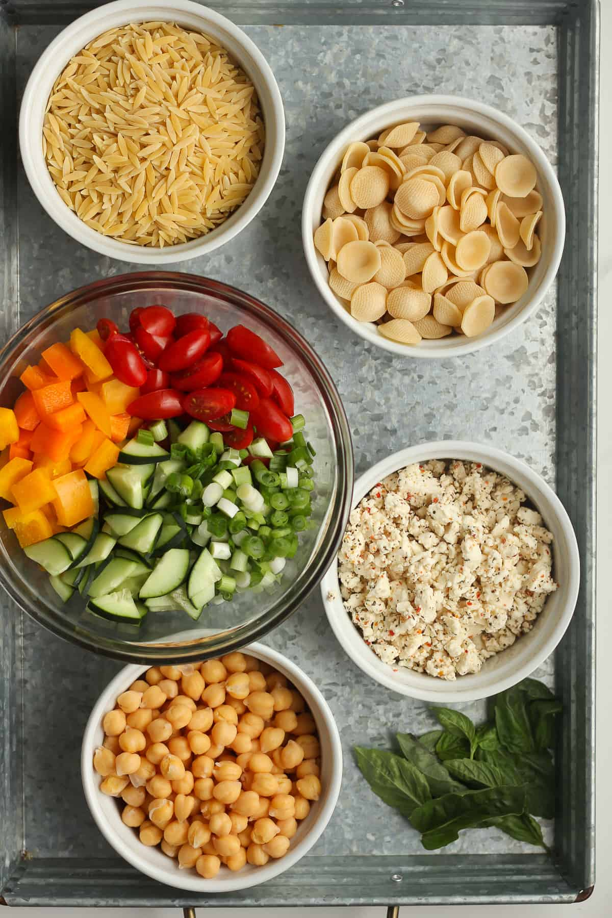 A tray of the pasta salad ingredients.