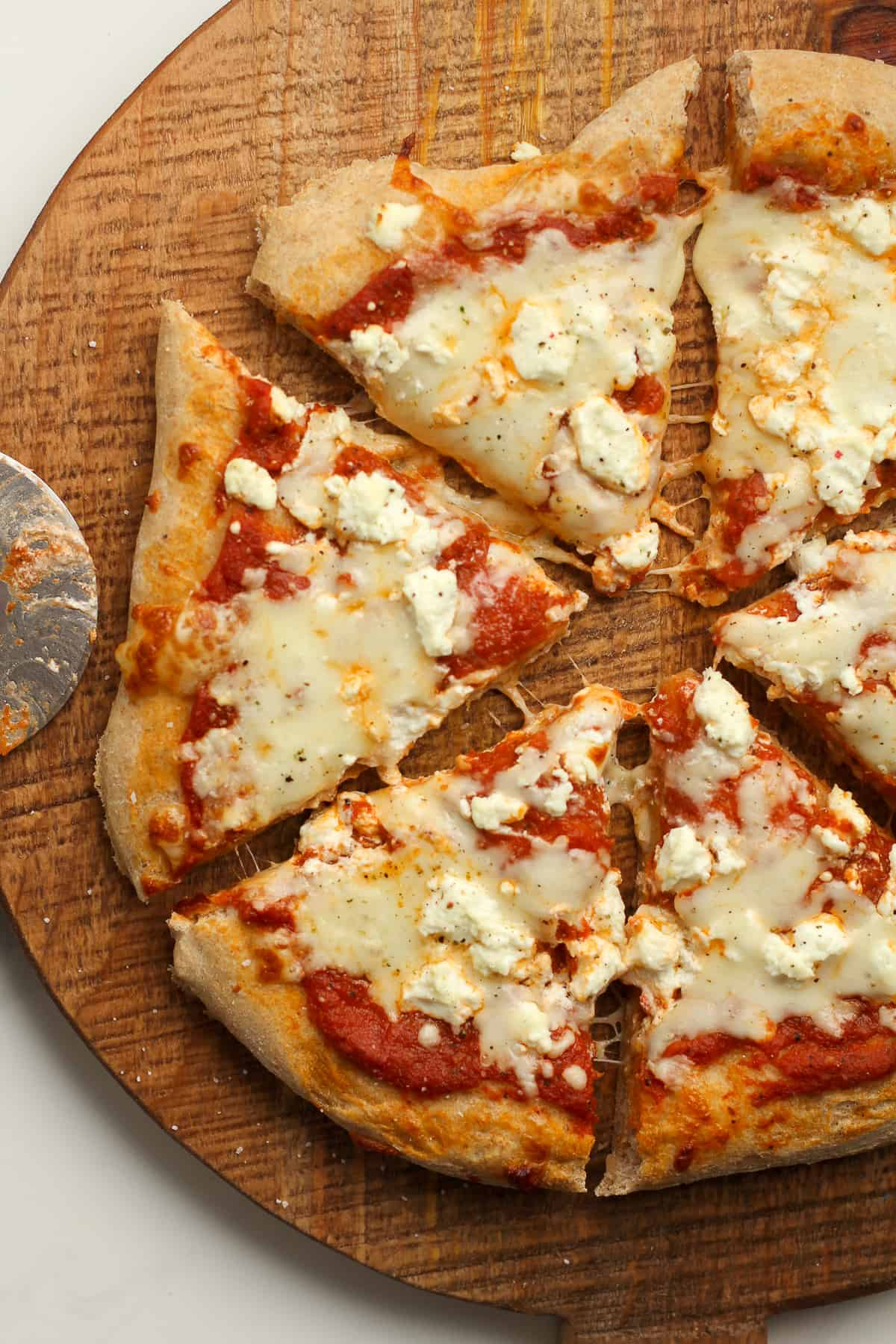 Overhead shot of sliced cheese pizza.