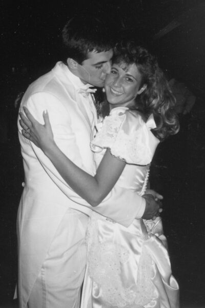 Mike and I at our wedding dance. Him kissing me on the cheek.
