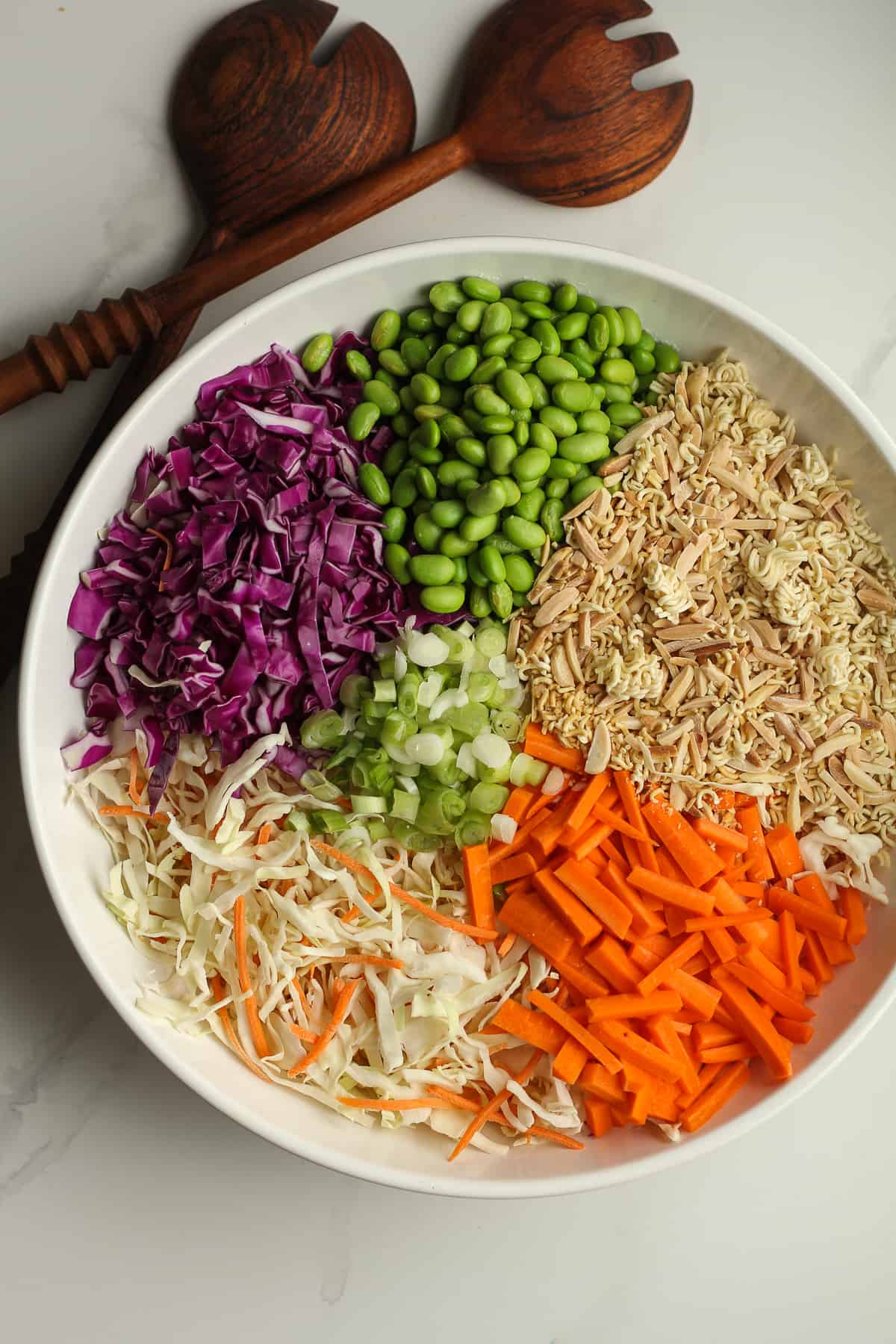 A bowl of the salad divided by ingredient.