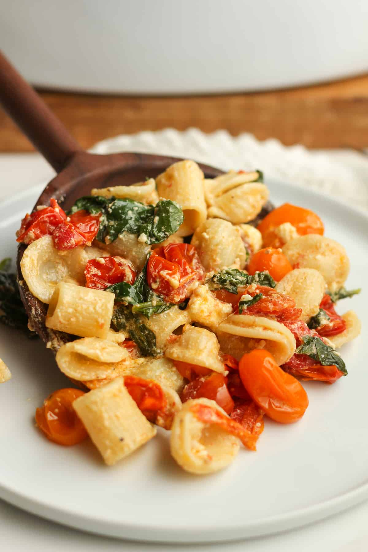 A spoonful of feta pasta on a plate.