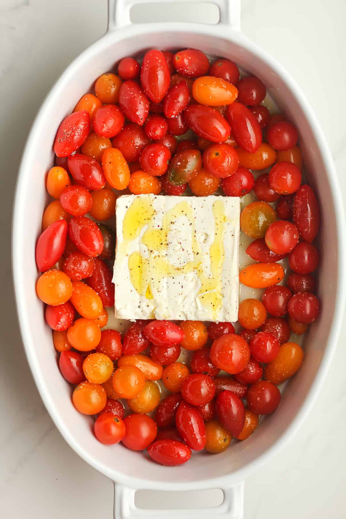 A dish of the tomatoes and cheese with olive oil.