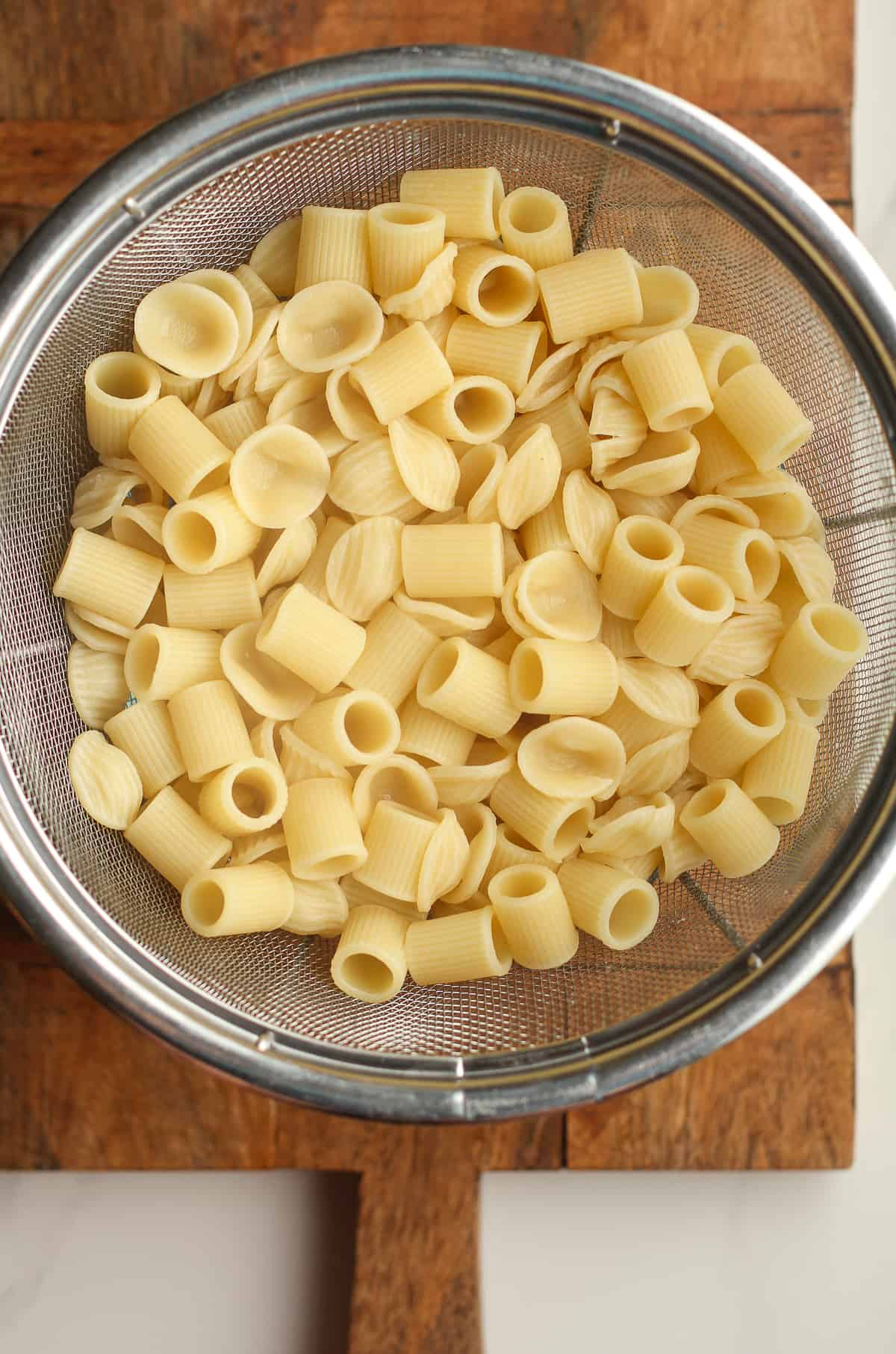 A strainer of cooked pasta.