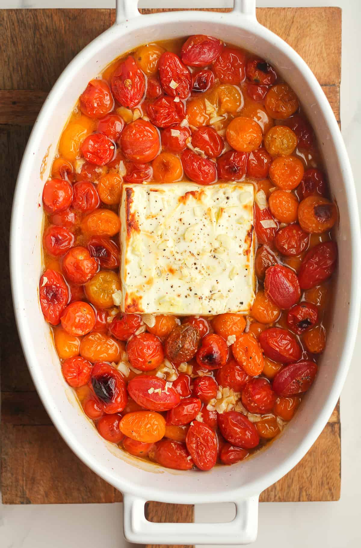 The dish of the baked tomatoes and feta cheese.