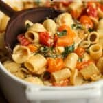 A side view of a spoonful of baked feta pasta.
