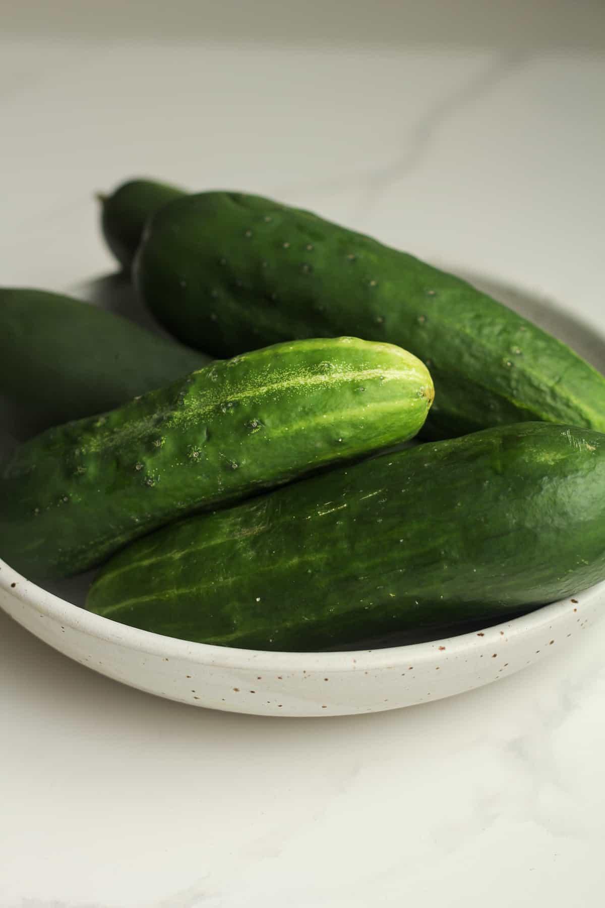 Ak bowl of cucumbers.