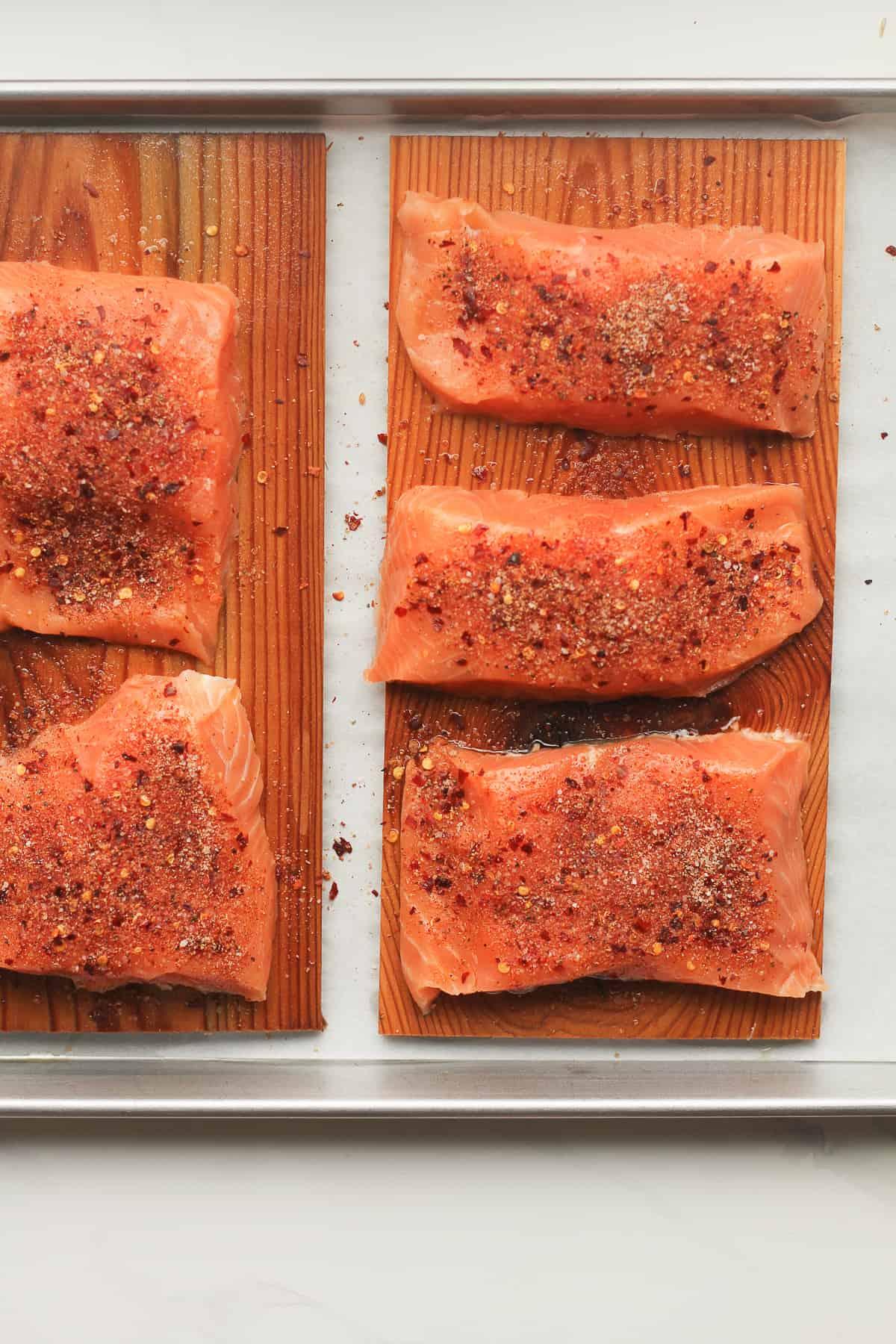 Raw salmon on cedar planks.