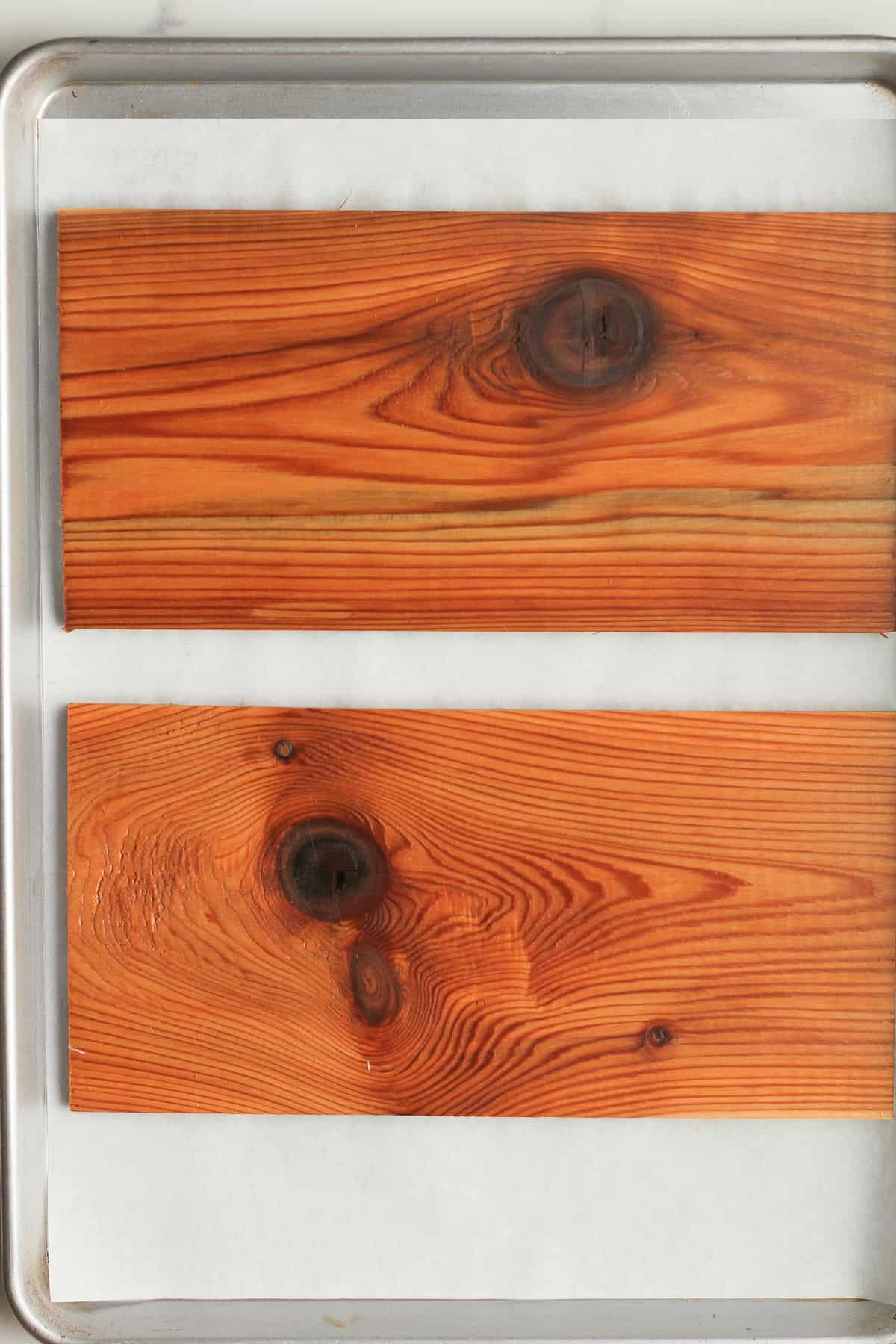 Two cedar planks after soaking.