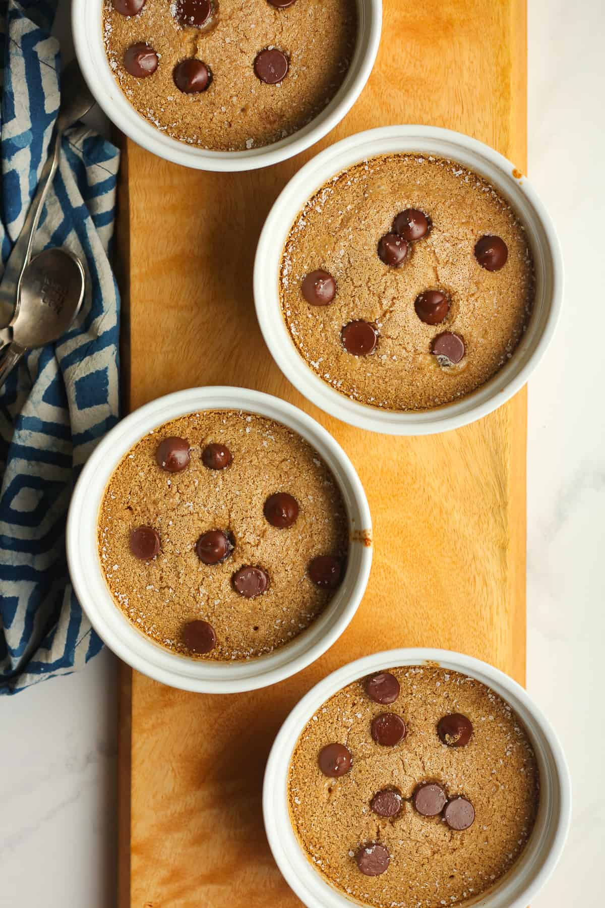 Four bowls of chocolate chip baked oatmeal.