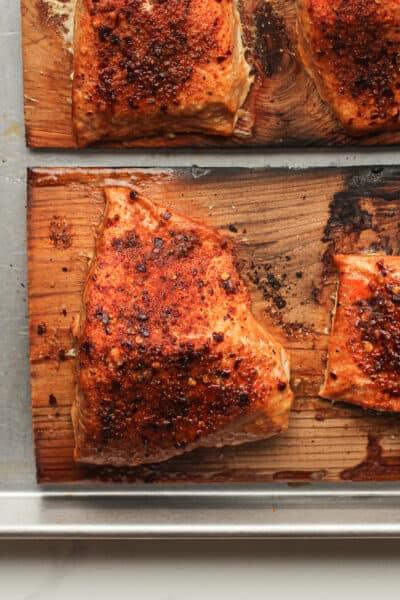 Closeup on a piece of salmon on cedar plank.