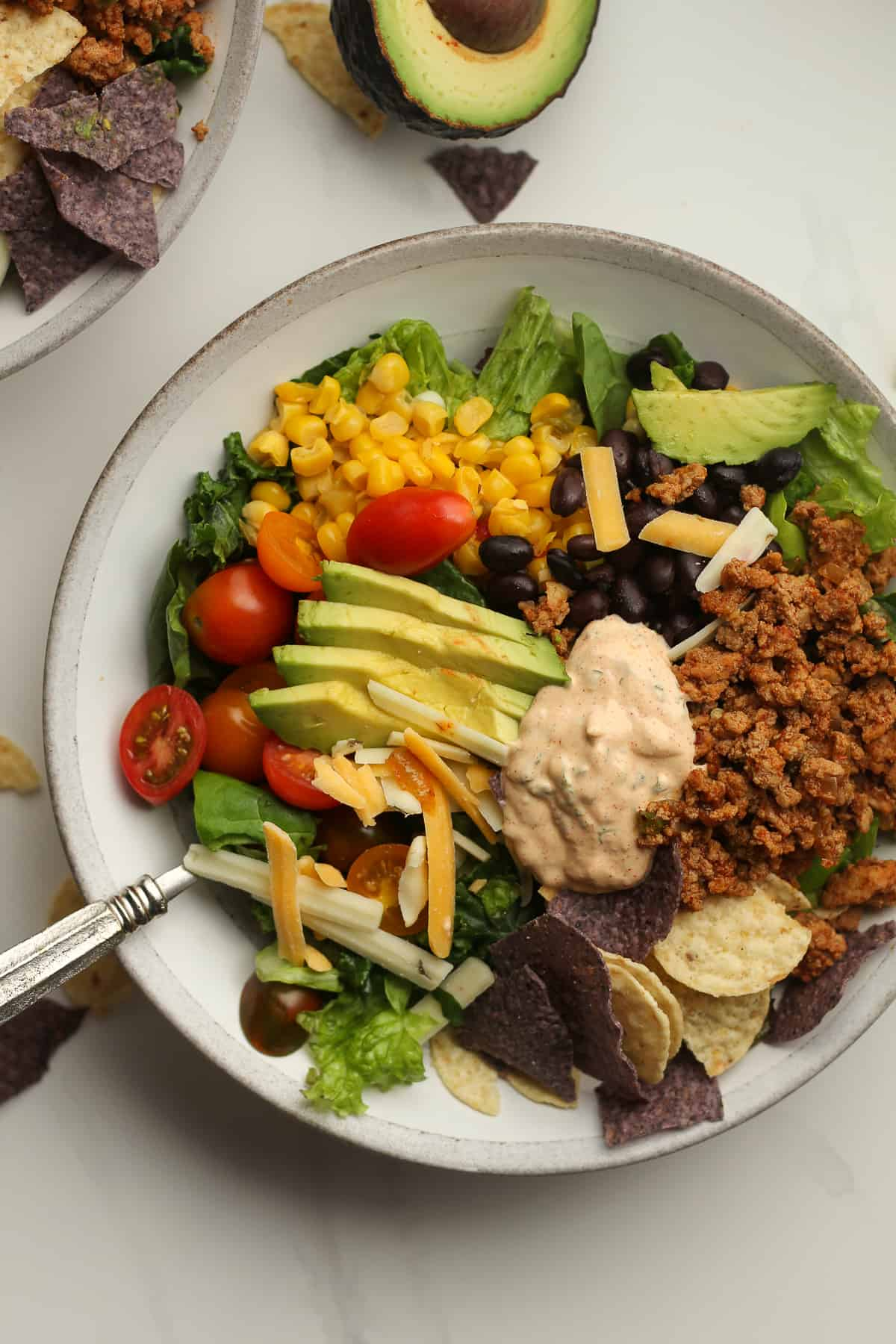 Closeup on a bowl of healthy taco salad recipe with chipotle ranch dressing.