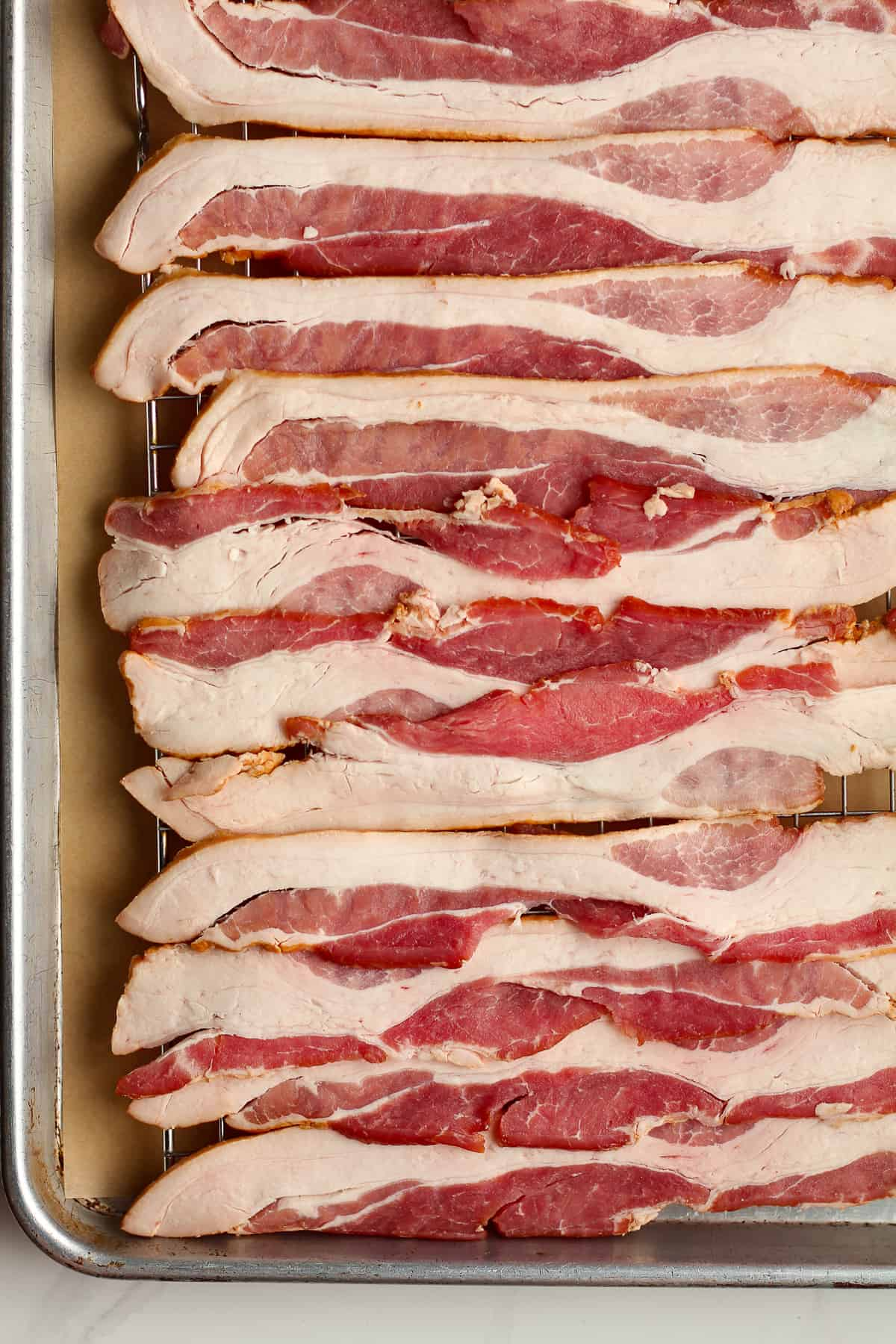 The raw bacon.