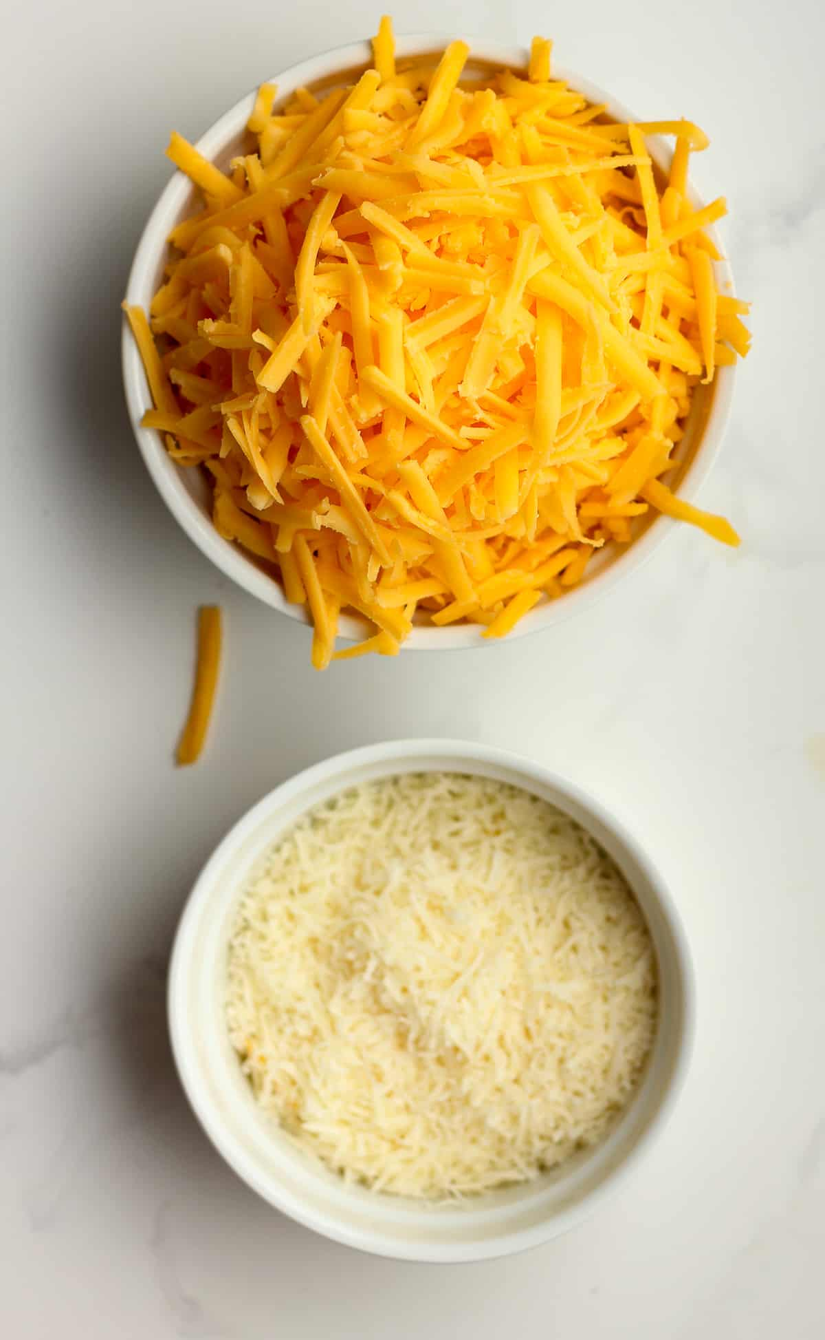 Bowls of the shredded cheese.